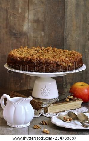 Piece of apple pie with walnut and sugar glaze. - stock photo