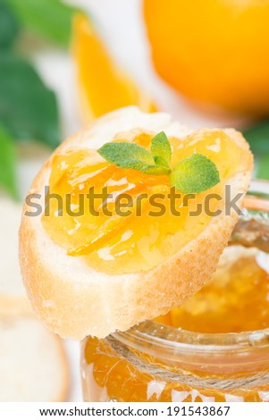 piece of baguette with orange marmalade, close-up - stock photo