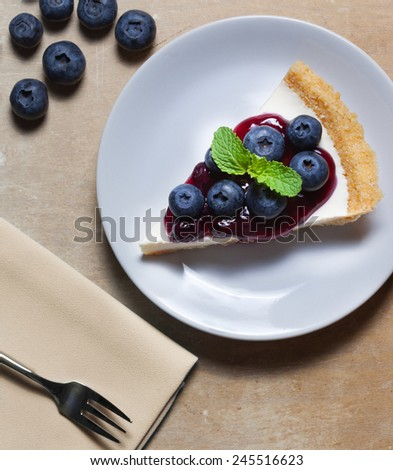 piece of blueberry cheesecake on plate - stock photo