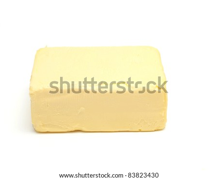 piece of butter on white background - stock photo