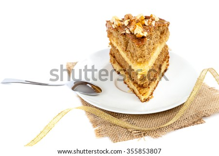 Piece of cake on a saucer with a spoon isolated on white background. - stock photo