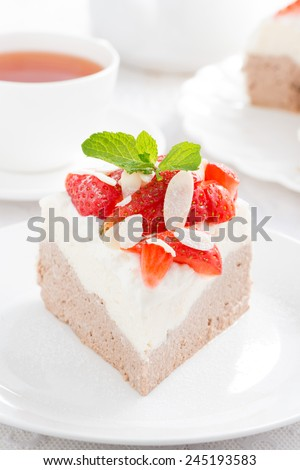 piece of cake with whipped cream and strawberries close-up, vertical, close-up - stock photo