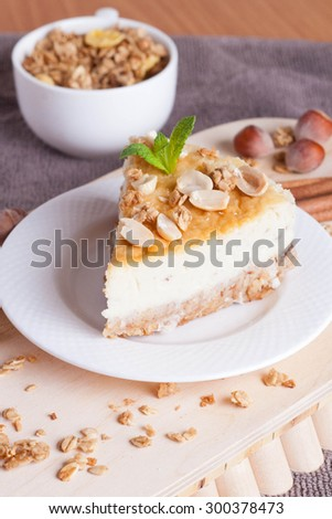 piece of cheesecake on wooden board,  close-up, vertical - stock photo