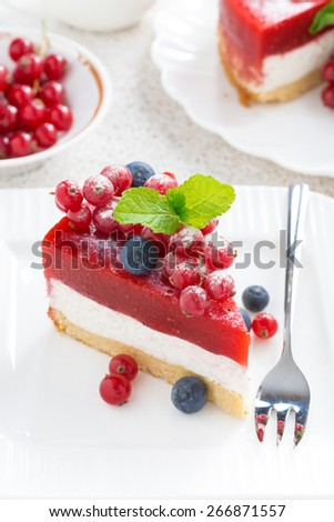 piece of cheesecake with berry jelly on a white plate, top view, vertical - stock photo
