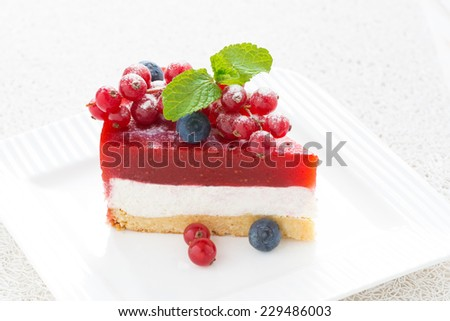 piece of cheesecake with strawberry jelly on a plate, close-up, horizontal - stock photo