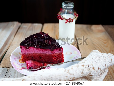 Piece of cherry cake and milk in a bottle - stock photo
