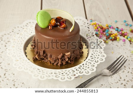 Piece of chocolate cake with icing - stock photo