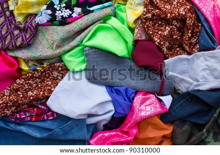 Piece of cloth. Pile piece of fabric scraps together into a colorful work of art. - stock photo