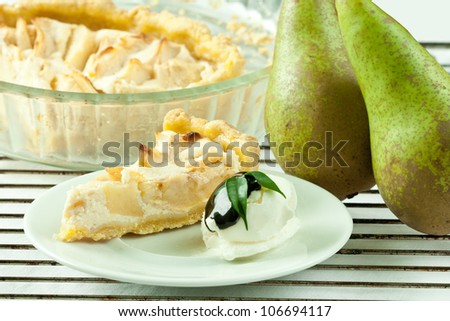 Piece of cottage cheese cake with pear and vanilla ice cream. - stock photo