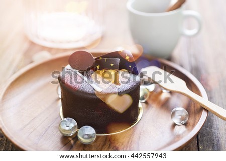 Piece of Dark chocolate cake on wooden background,selective focus,on bright background - stock photo