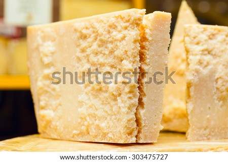 Piece of Grana Padano or Parmigiano Reggiano aka Parmesan cheese  - stock photo
