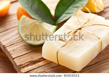 Piece of handmade lemon soap. - stock photo