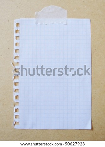 piece of lined paper stuck with tape - stock photo