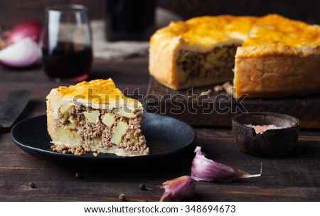 Piece of Meat Pie with wine Wooden background - stock photo