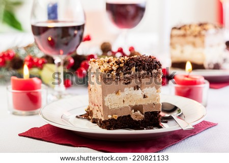 Piece of meringue cake with chocolate - stock photo