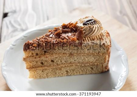 piece of mocha butter cream cake - stock photo