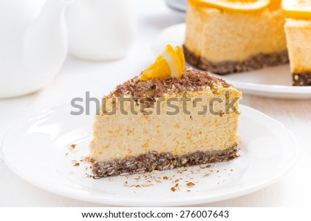 piece of orange cheesecake on a white plate, close-up - stock photo