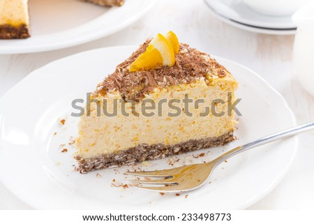 piece of orange cheesecake with chocolate on a plate, top view, horizontal - stock photo
