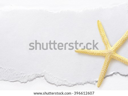 Piece of paper with sea star on white - stock photo