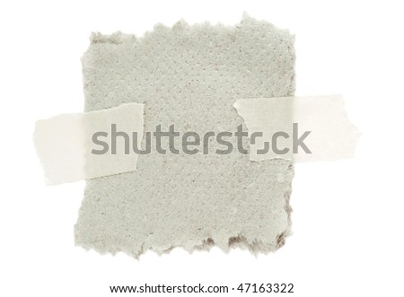 Piece of paper with torn edges attached with masking tape - stock photo