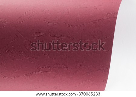 Piece of red texture cardboard on gray background - stock photo