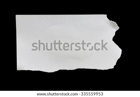 piece of ripped white paper on black background with clipping path. - stock photo
