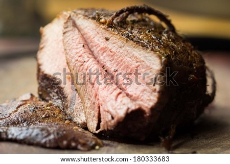 Piece of roasted juicy beef, veal, cut in slices, delicious homemade dinner - stock photo