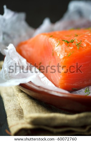 Piece of smoked salmon with dill on the plate,shallow focus - stock photo