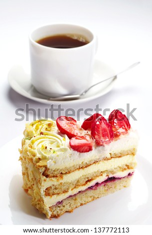 Piece of strawberry cake and cup of coffee - stock photo