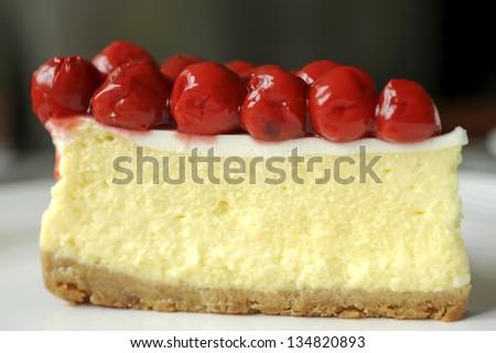 piece of tasty cherry cheesecake - stock photo