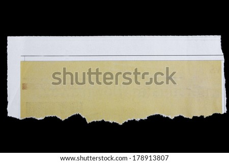 Piece of torn paper on black. Copy space - stock photo