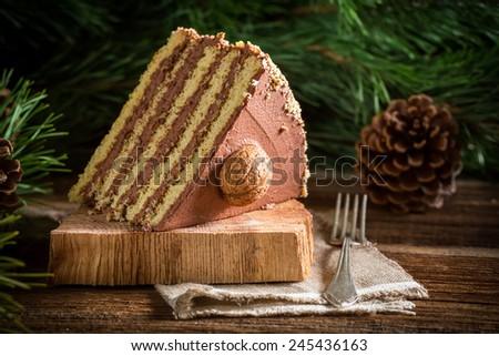 Piece of walnut cake on wood - stock photo