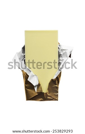 Piece of white chocolate in golden foil isolated over white - stock photo