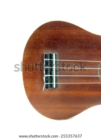 piece of wood for tightening or loosening the strings of string instrument Ukulele - stock photo