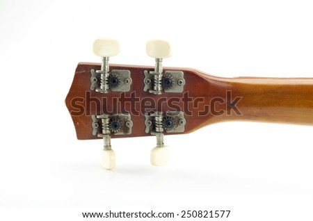 piece of wood for tightening or loosening the strings of string Ukulele  - stock photo