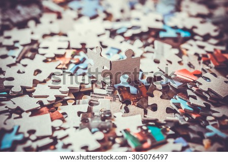 pieces of a puzzle - stock photo