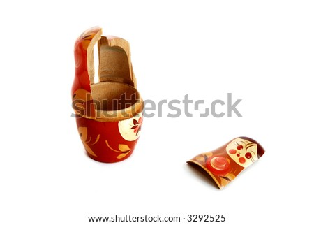 Pieces of broken nesting doll lying on a white background - stock photo