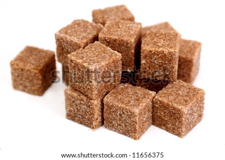 pieces of brown sugar on white - stock photo