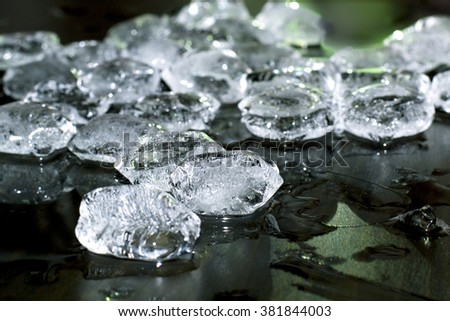 pieces of crushed ice on black background - stock photo