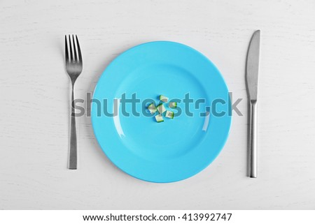 Pieces of cucumber in a blue plate on white table.. Top view. - stock photo