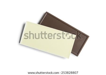 Pieces of dark and white chocolate on white background - stock photo