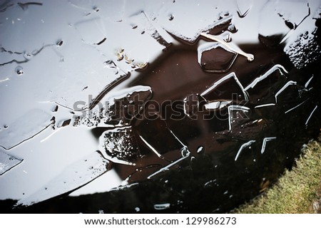 Pieces of ice in the water/Broken ice in a pond - stock photo