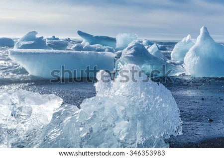 pieces of iceberg afloat in the ocean - stock photo