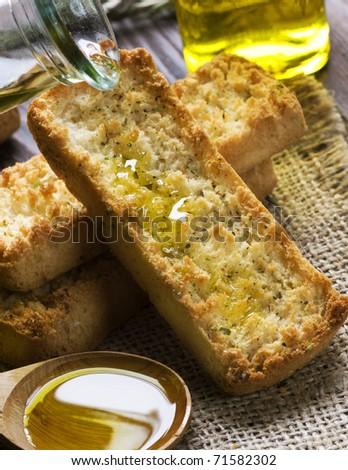 Pieces of Italian Bruschetta with Olive Oi - stock photo