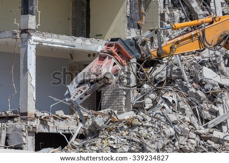 Pieces of Metal and Stone are Crumbling from Demolished - stock photo