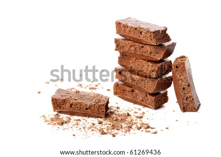 Pieces of milk aerated chocolate isolated on white - stock photo