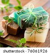 Pieces of natural soap with herbs. - stock photo