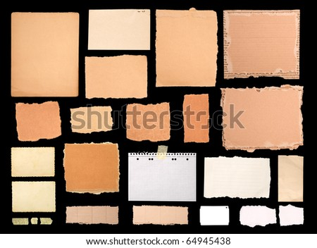Pieces of notepaper and cardboard isolated on black - stock photo