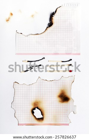 Pieces of paper and matches burned in various shapes. - stock photo