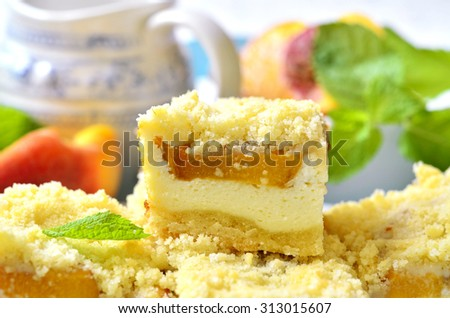 Pieces of peach pie with curd on a light background. - stock photo